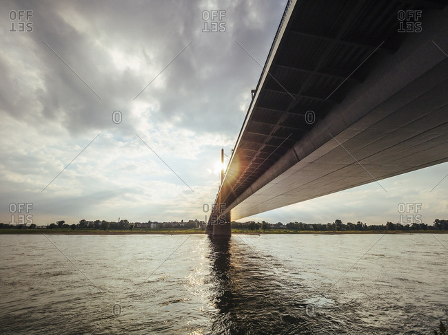 Germany- Duesseldorf- Rheinkniebruecke over Rhine River at backlight