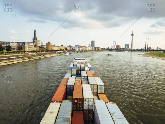 Germany- Duesseldorf- cargo ship transporting containers at Rhine River