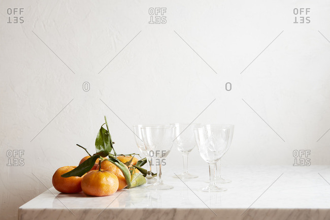 Goblet glasses by oranges
