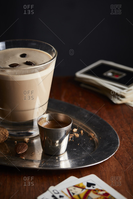 Coffee cocktail and playing cards