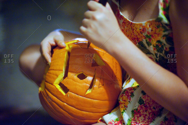 Woman carving pumpkins