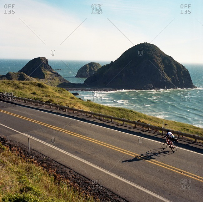 A man cycles along the coastal route on a bike in Southern Oregon