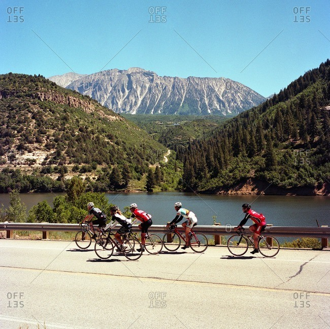 Men riding in formation during bicycle tour of Colorado