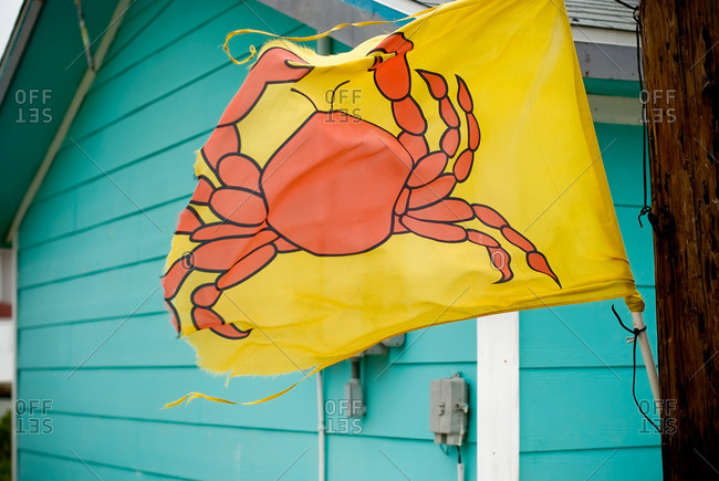 Crab flag outside of a blue building