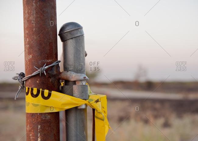 Caution tape around fence post