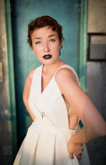 Woman wearing white dress and blue lipstick