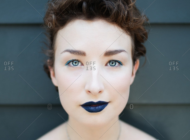 Woman wearing blue lipstick and eyeliner