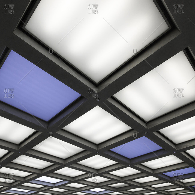 Grid of modern ceiling lights in white and blue