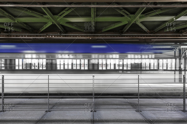 Train speeding past an platform in a blur