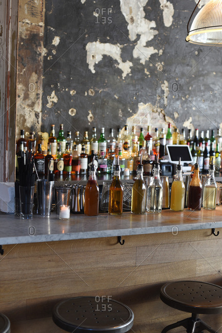 Bottles of liquor and mixers on a countertop at a bar