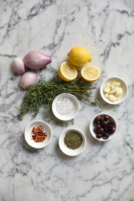 Lemons, shallots and seasonings on a marble surface
