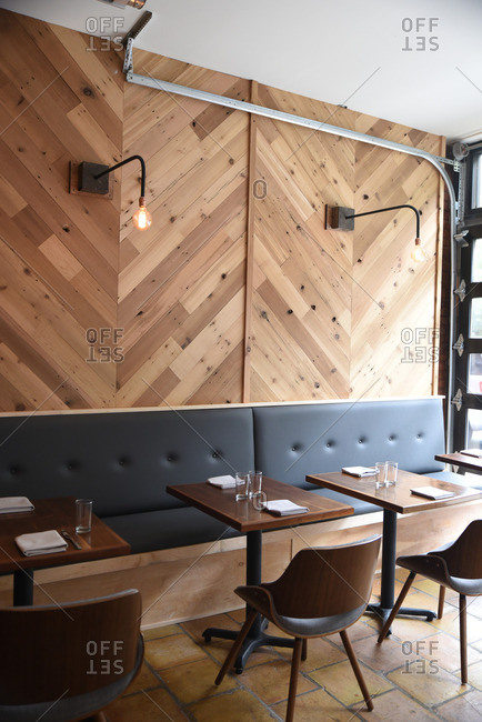 Elegant restaurant with herringbone wood walls