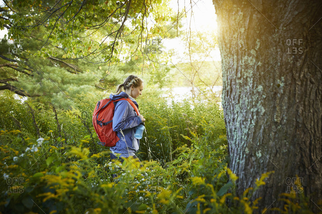 Woman hiking towards a lake