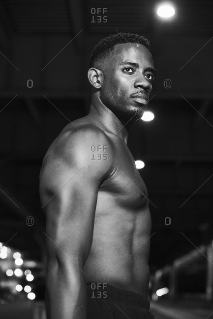 Portrait of a shirtless man during a workout in black and white