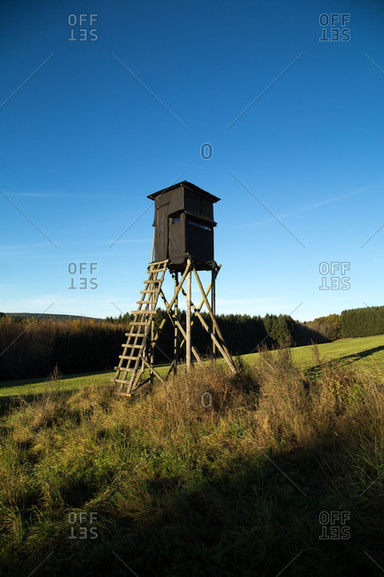 Hunting blind in a field