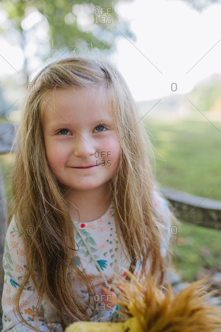 Caucasian girl in rural summer setting