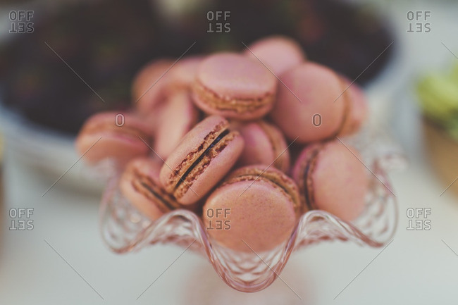 Pink macarons in a dish