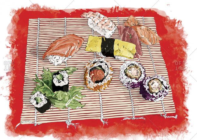 Various types of sushi on mat
