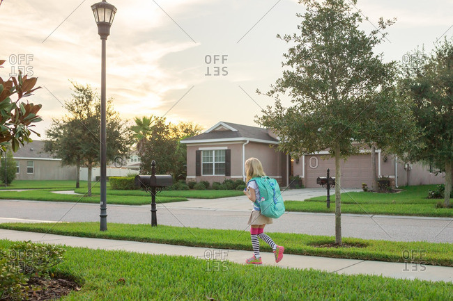 Girl walking to school with backpack