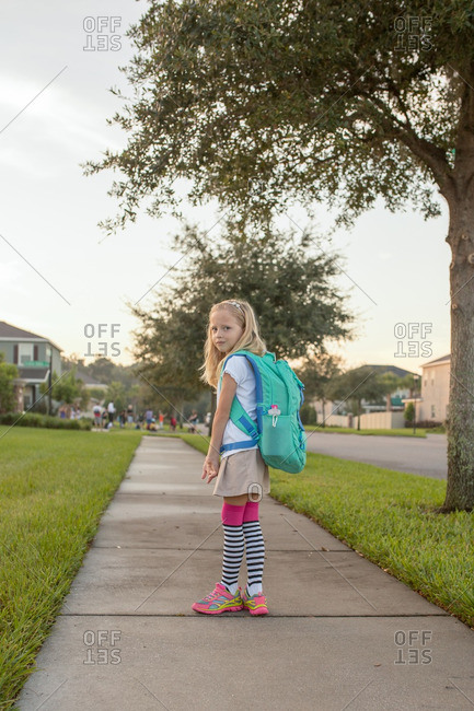 Girl walking to the bus stop before school