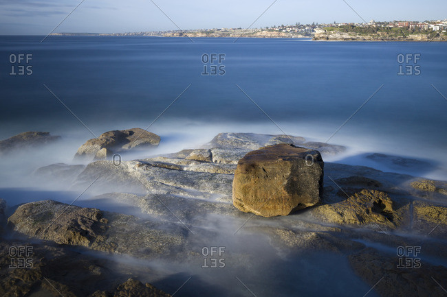 Composition of rocks in the ocean, taken with a long exposure at Bondi beach, one of the famous beaches in Sydney, Australia