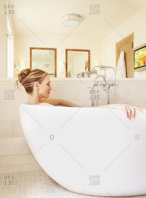 Woman soaking in bathtub