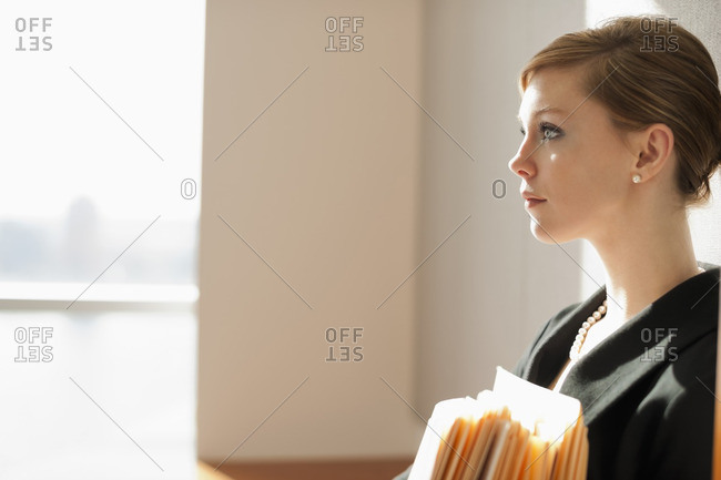 Caucasian businesswoman holding files