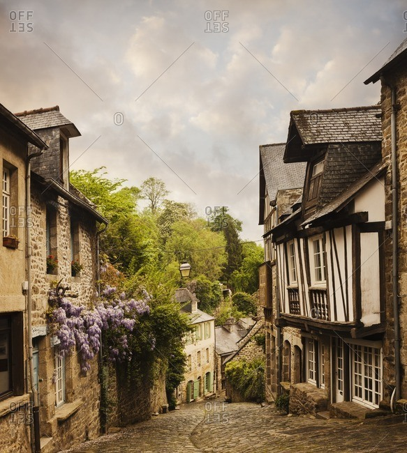 Quaint French houses and cobblestone street