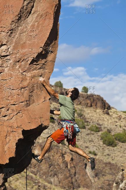 Caucasian man climbing rocks