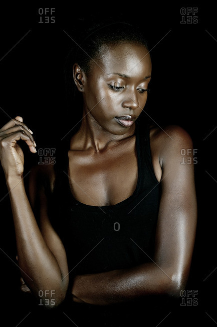 Serious African American woman looking down