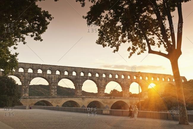 Sun shining through aqueduct