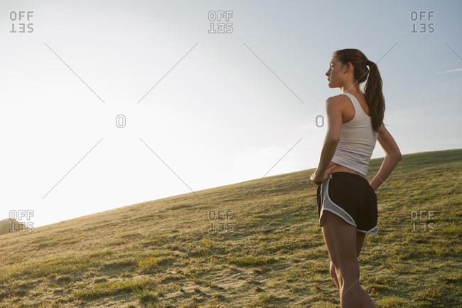 Caucasian runner standing in field