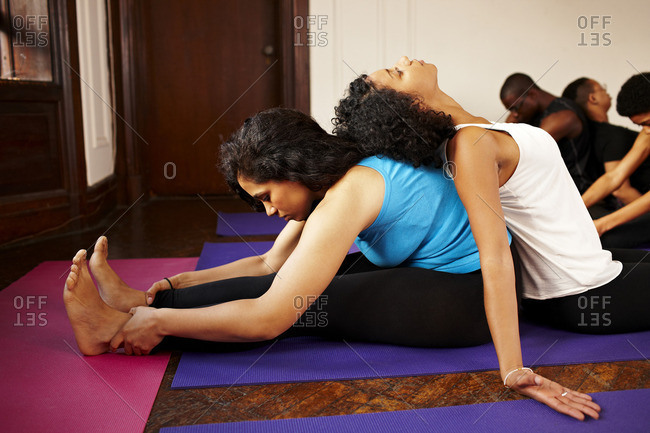 Women stretching together in yoga class