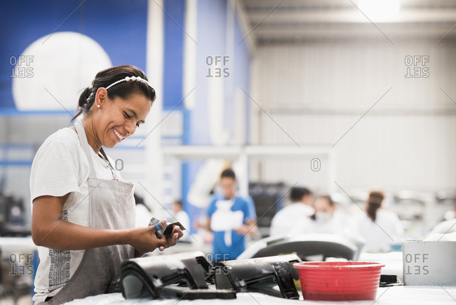 Worker smiling in manufacturing plant