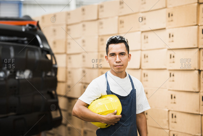 Worker standing in manufacturing plant