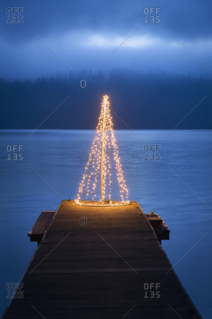 String of lights in tree shape on wooden pier