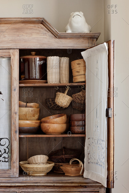 Wooden bowls in an old wooden kitchen cupboard