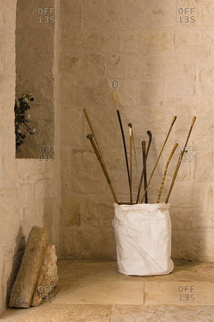 Selection of sticks in a white container