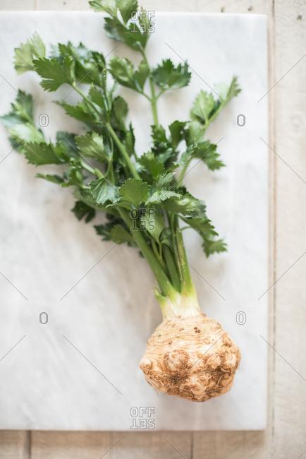 A celeriac root on cutting board