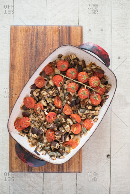 Cooked veggies filling casserole pan
