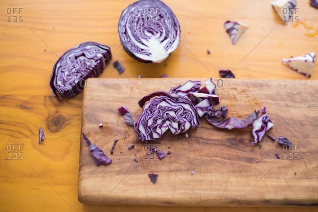 Purple cabbage slices on a cutting board