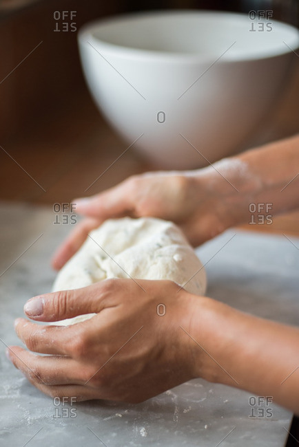 Hand preparing homemade dough
