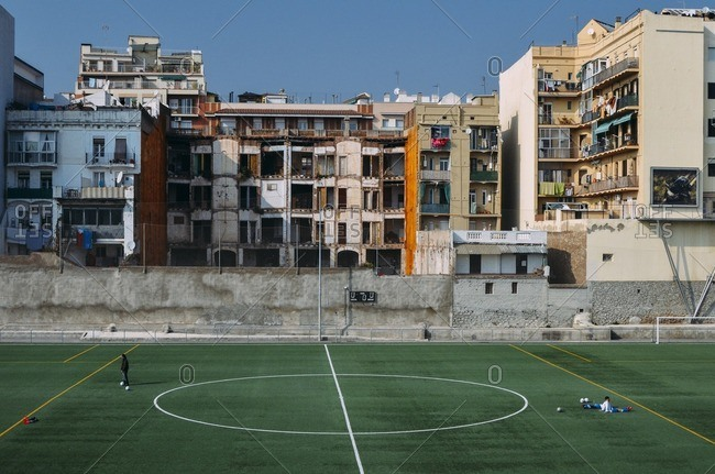 Barcelona, Spain - February 12, 2011: Football pitch and blocks of flats