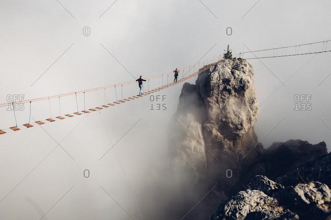 Tourists crossing a rope bridge in Yalta, Ukraine