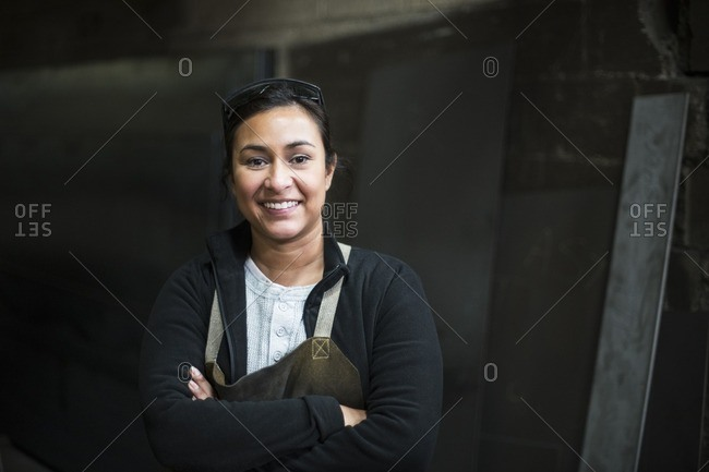 Mixed race worker smiling in factory