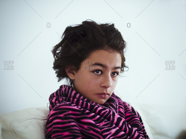 Mixed race girl wrapped in bathrobe