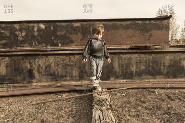 Caucasian boy walking on wall