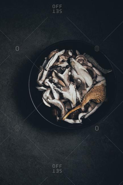 Bowl of raw foraged mushrooms