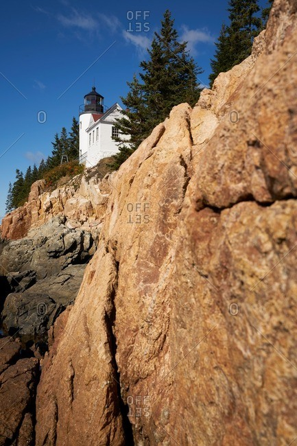 A lighthouse on rock cliff, Maine