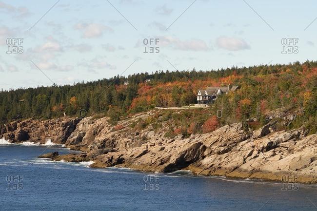 House nestled in coastal hills, Maine